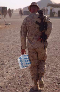 A U.S. Marine carries water back to his tent in Afghanistan. Maintaining critical supplies of water in the field consumes fuel and risks lives. Source: DoD Photo by Lance Cpl Phillip Elgie, U.S. Marine Corps